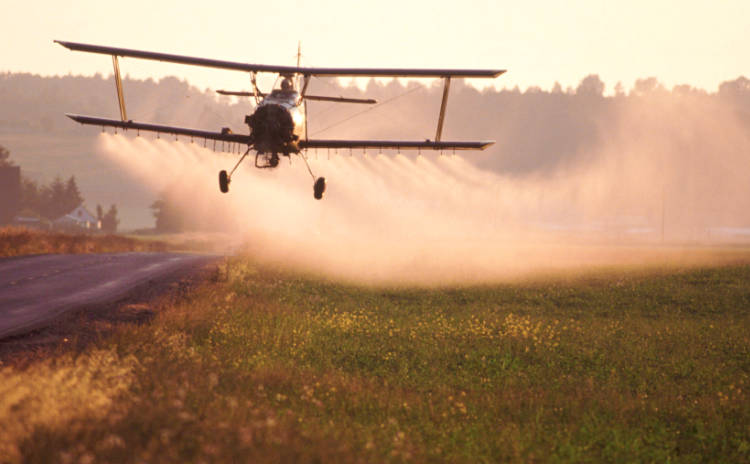 Spraying biocides on crops