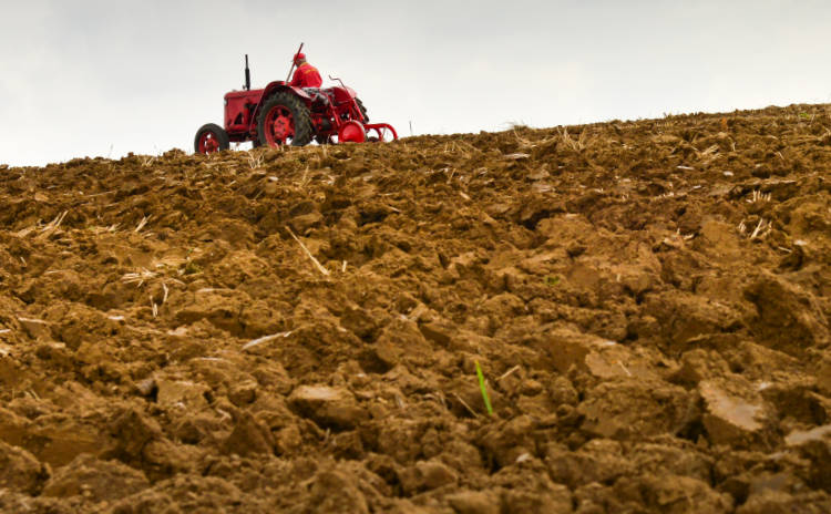 Tractor plowing soil